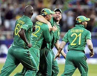 South Africa's Lonwabo Tsotsobe, Johan Botha, Graeme Smith and JP Duminy celebrate the wicket of India's Yuvraj Singh (not in picture) in Durban