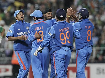 Indian players celebrate with Harbhajan Singh after dismissing South Africa's Colin Ingram on Saturday