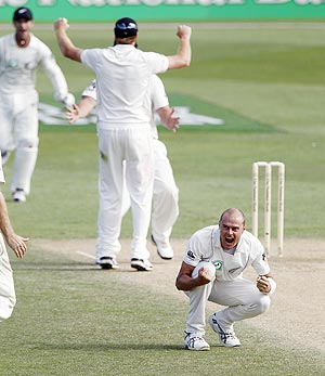 New Zealand's Chris Martin celebrates after dismissing Pakistan's Misbah-ul-Haq