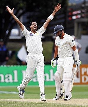Pakistan's Umar Gul celebrates after claiming the wicket of New Zealand's Brent Arnel (right) on day four of the second Test in Wellington on Tuesday