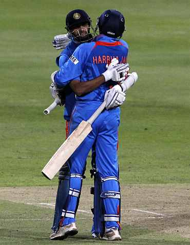 India's Ashish Nehra and Harbhajan Singh celebrate after winning the third ODI against South Africa in Cape Town