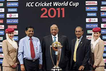 ICC President Sharad Pawar, ICC CEO Haroon Lorgat and ICC Cricket World Cup 2011 Tournament Director Proff. Ratnakar Shetty pose with 2011 Cricket World Cup trophy in Mumbai