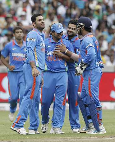 Indian players celebrate fater a fall of a South African wicket