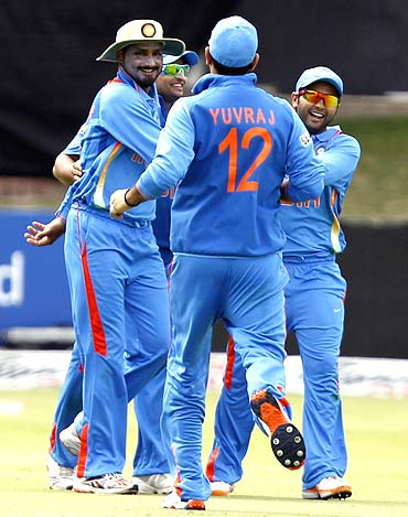 Indian players celebrate the dismissal of South African captain Graeme Smith on Friday