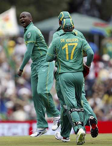 South Africa's Lonwabo Tsotsobe (L) celebrates after picking up an India wicket