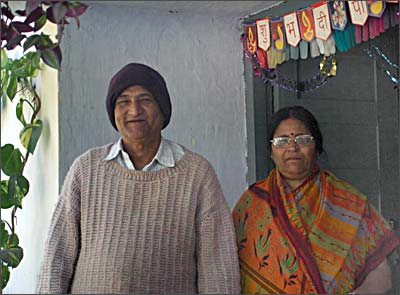 Dhoni's parents Pan and Devki Singh in front of their home in Ranchi