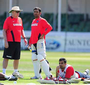 India coach Duncan Fletcher chats with MS Dhoni during a net session in Taunton
