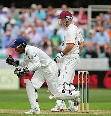 Andrew Strauss is caught by wicketkeeper Wriddhiman Saha during day one of the tour match between Somerset and India