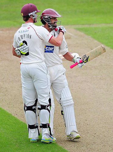 Arul Suppiah is congratulated by Nick Compton after completing his century