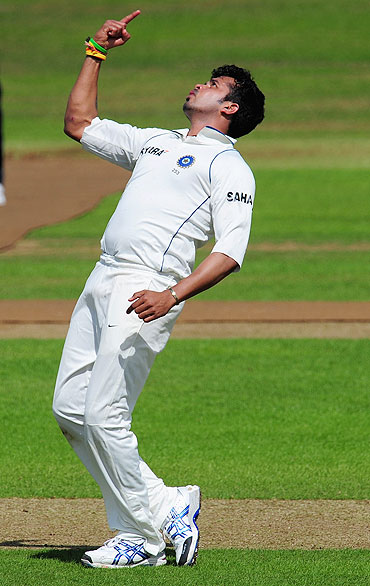 India bowler S Sreesanth celebrates the wicket of Arul Suppiah