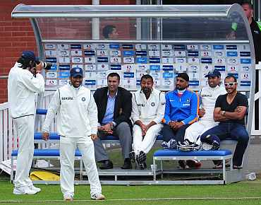 India bowler Ishant Sharma photographs the Indian bench during day two of the tour match