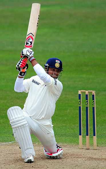 Suresh Raina hits a boundary during his knock against Somerset