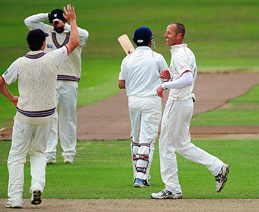 Charl Willoughby celebrates after dismissing Gautam Gambhir during the tour game