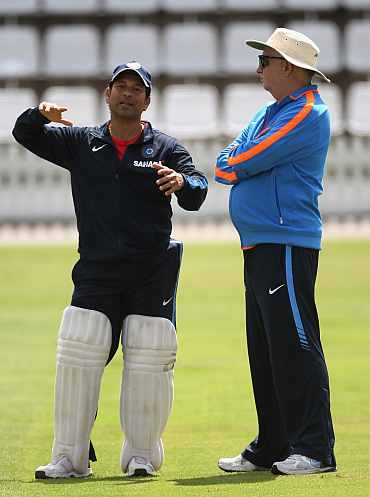 Sachin Tendulkar talks to Duncan Fletcher during a practice session at Lord's cricket ground