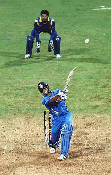 Mahendra Singh Dhoni hits Kulasekara over long-on for a six to seal victory in the World Cup final at the Wankhede stadium