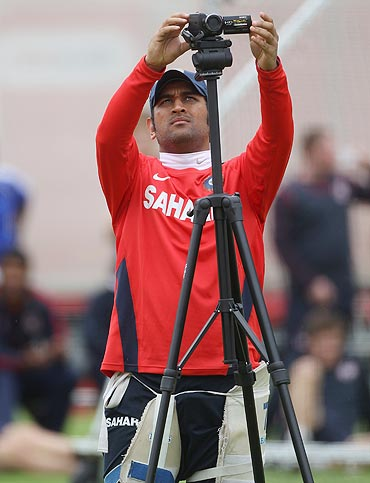 MS Dhoni sets up a camera during the India nets session