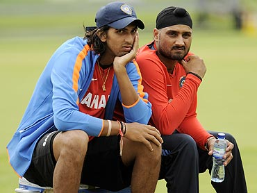 India's Ishant Sharma (left) and Harbhajan Singh take a break during a training session