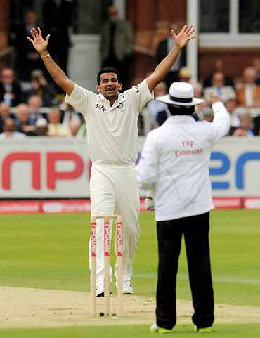 Umpire Asad Rauf raises the finger to dismiss Alastair Cook