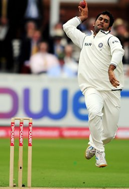 Mahendra Singh Dhoni bowls on Day 2 of the first Test