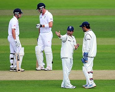 India captain Mahendra Singh Dhoni (right) listens to some advice from Sachin Tendulkar