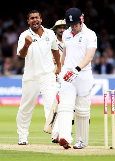Praveen Kumar celebrates as Ian Bell departs