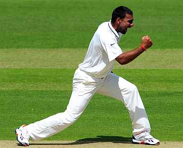 Praveen Kumar celebrates after picking up a wicket