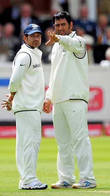 MS Dhoni and Sachin Tendulkar chat during the Test match at Lord's