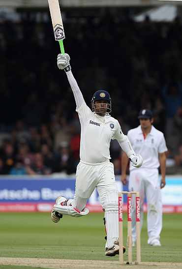 Rahul Dravid celebrates after scoring his century against England