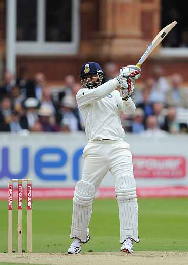 Praveen Kumar hits a boundary during his knock against England
