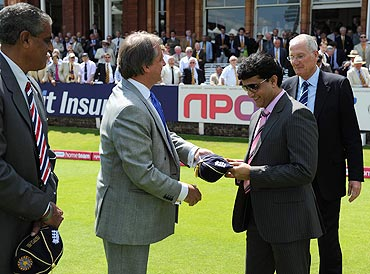 Sourav Ganguly and Bob Willis receive caps from ECB Chairman Giles Clarke and Honorary Joint Secretary of the BCCI Sanjay Jagdale in honour of the centenary match between England India on Sunday