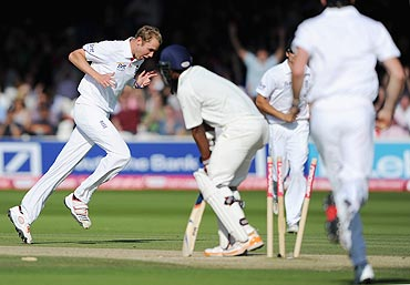 Stuart Broad celebrates after bowling Abhinav Mukund
