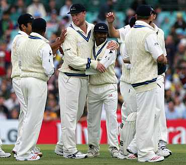 World XI Team celebrate after picking up a wicket against Australia