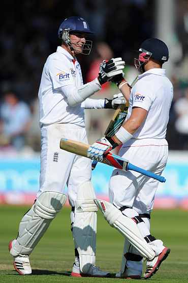Stuart Braod and Matt Prior celebrate after putting a century stand
