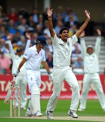 Ishant Sharma successfully appeals for the wicket of Alastair Cook
