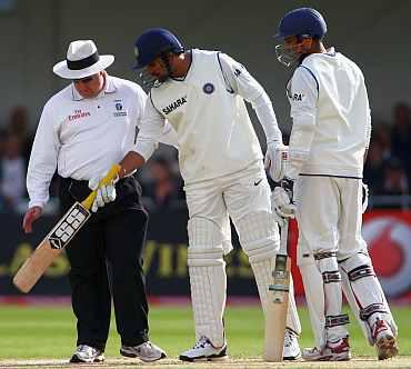 Zaheer Khan checks the pitch