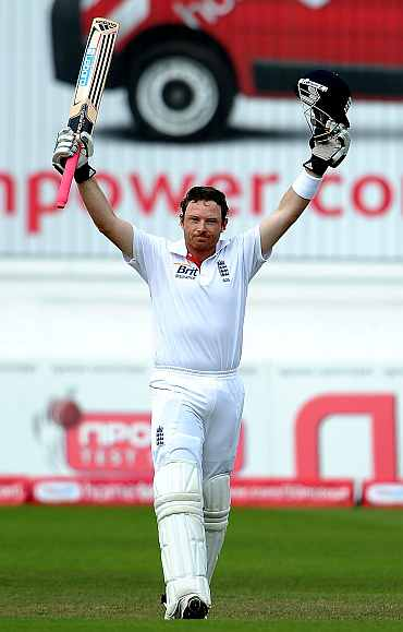 Ian Bell celebrates after completing his century against India