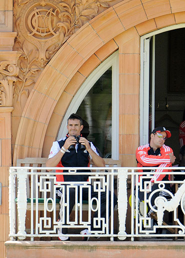 England's Kevin Pietersen (left) and Andrew Strauss sit on the dressing room balcony after both were dismissed during the second Test on Friday