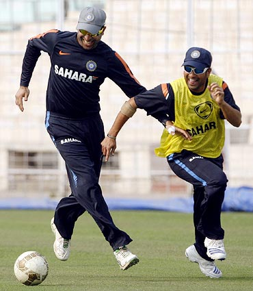 VVS Laxman (left) plays football with Sachin Tendulkar during a training session