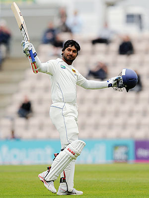 Sri Lanka's Kumar Sangakkara celebrates after completing his century against England on Monday
