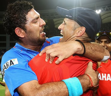 Yuvraj celebrates with former coach Gary Kirsten after the World Cup final
