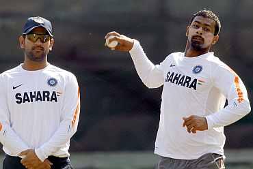 Mahendra Singh Dhoni and Praveen Kumar