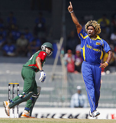 Lasith Malinga (right) celebrates after dismissing Kenya's Seren Waters