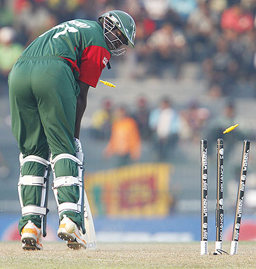 Kenya's Peter Ongondo looks back at the stumps as he is bowled by Lasith Malinga