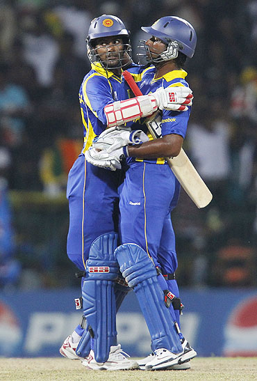 Sri Lanka's captain Kumar Sangakkara (right) and Upul Tharanga celebrate after defeating Kenya
