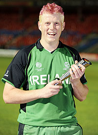 Ireland's Kevin O'Brien smiles while holding the man of the match trophy