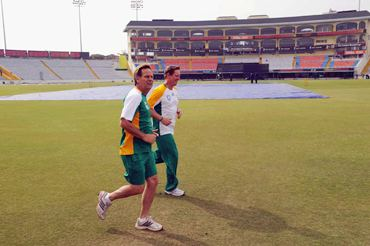 The pitch at the PCA stadium is covered as psychologist Henning Gericke and Andrew Hudson train during the South Africa team's practice session.