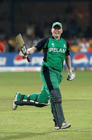 Kevin O'Brien celebrates after reaching his century
