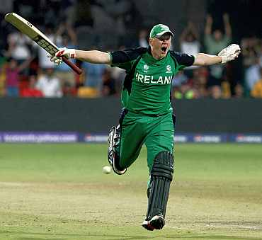 Kevin O'Brien celebrates after reaching his century against England