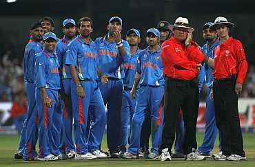 The Indians wait for the third umpire's decision on Ian Bell on Sunday