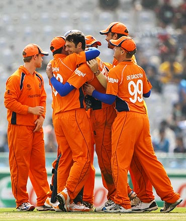 Bernard Loots is congratulated by team-mates after getting the wicket of Graeme Smith